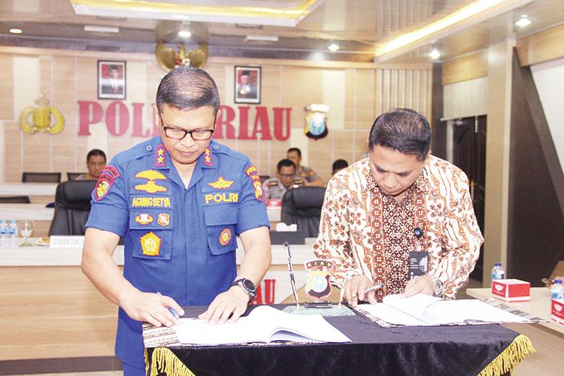 Bank Bukopin Dukung Polda Riau Distribusikan Dana Penanggulangan Karhutla melalui Aplikasi