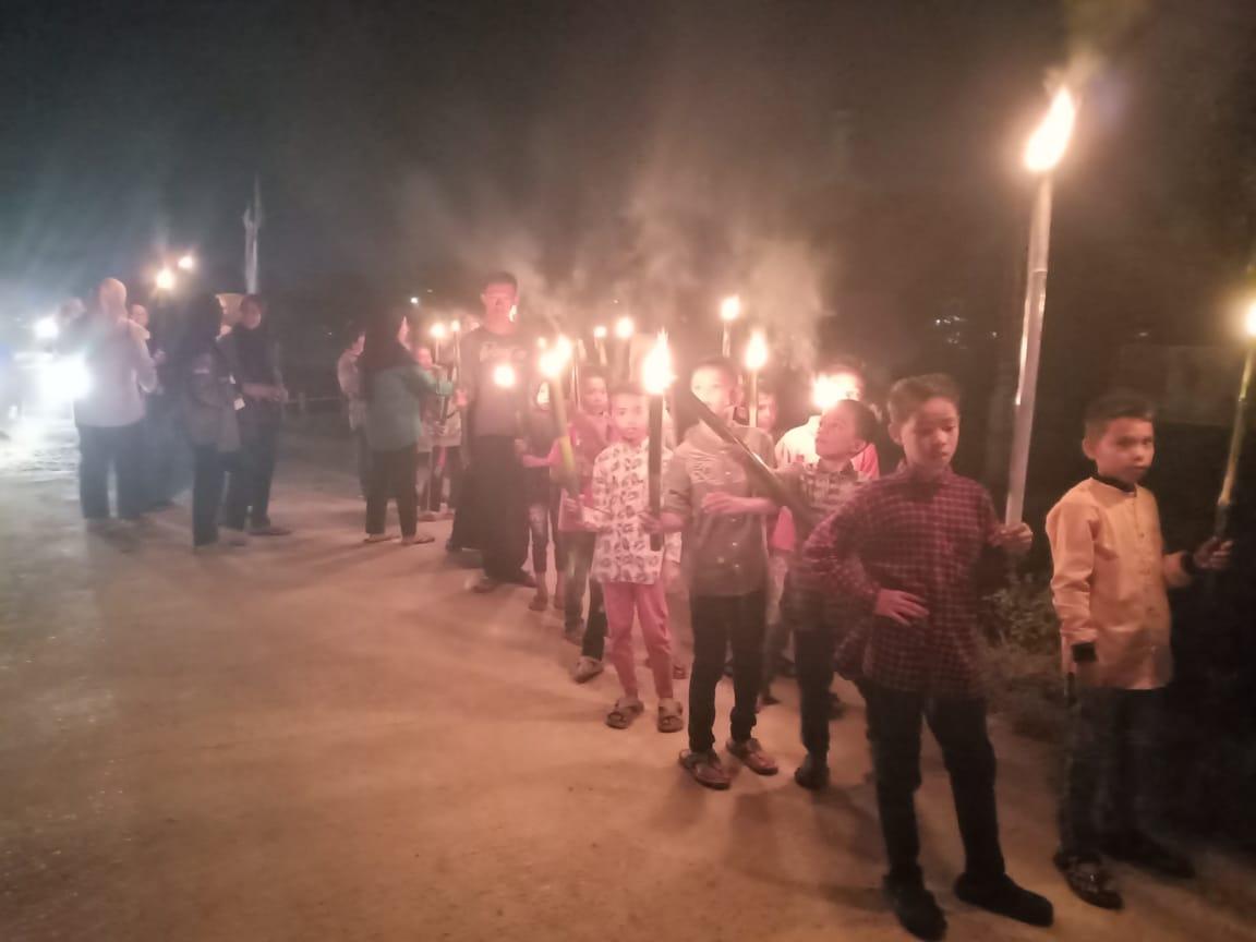 Aktif Bersama Masyarakat di Pawai Obor
