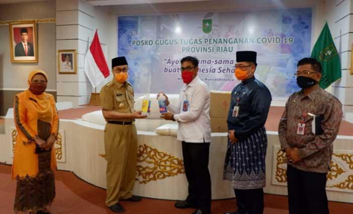 KPU Inhu Terima 12 Ribu Masker dan 40 Liter Hand Sanitizer dari Pemprov Riau