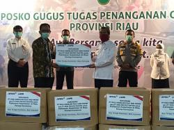 Pemprov Riau Terima Bantuan APD dari RAPP dan APR