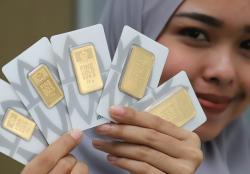 Harga Emas Global Naik, Antam Turun Rp3.000 per Gram