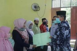 Bupati Serahkan 254 Sertifikat PTSL di Sabak Auh