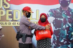 SPN Polda Riau Gelar Vaksinasi dan Berikan Sembako ke Warga Kampar