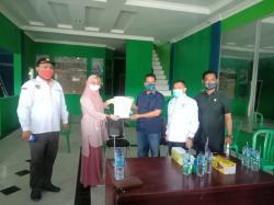 KPUD Kuansing Antar Langsung Penetapan Mursini-Indra Putra Sebagai Paslon Pilkada