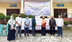 MI Al Fattaah dan Human Initiative Riau Salurkan Paket Sembako dan Donasi