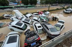 33 Orang Meninggal Akibat Banjir di Cina