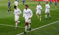 Dua Gol Varane Menangkan Madrid atas Tuan Rumah Huesca