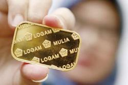 Rupiah Masih Melemah, Emas Dunia Stabil