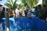 Gelar Baksos, Polresta Pekanbaru Tebar Benih Ikan