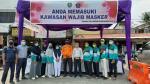 Mahasiswa KKN STAI Hubbulwathan Bantu Petugas Razia Masker